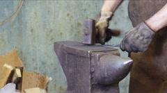 Blacksmith working on metal. Stock Footage