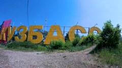 Big letters KUZBASS on the cliff in the pine forest Stock Footage