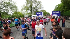 Many runners participated at Edinburgh Marathon Festival Stock Footage