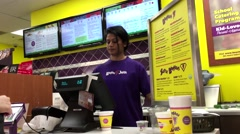 Customer redeem coupon for free drink at Booster Juice shop Stock Footage