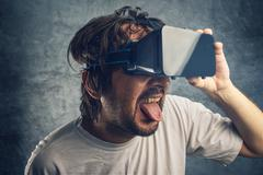 Man watching 3d virtual pornographic content - stock photo