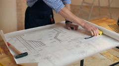 Builder finished his work with a blueprint - stock footage