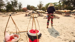Vendor Brings Food to Tourists on Sand Beach in Vietnam - stock footage