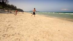 Boys Run into Azure Ocean Waves Swim Gambol in Foam Stock Footage