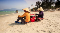 Vendors with Food Rest on Sand Beach Talk in Vietnam Stock Footage