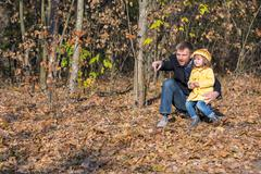 Father Playing with Little Baby Daughter in Autumnal Forest Stock Photos