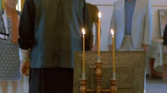 Priest in the Russian Orthodox Church, candles, in slow motion Stock Footage