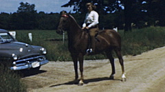 USA 1951: young girl riding a horse Stock Footage