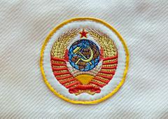 Fabric soviet USSR emblem with hammer and sickle - stock photo