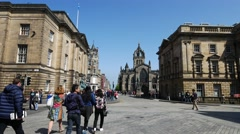 Many tourists walking and shopping at High Street in Edinburg Stock Footage