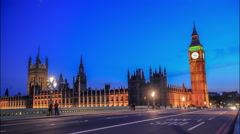 Time lapse footage of night time rush hour traffic on Westminster Bridge - stock footage
