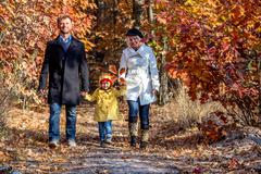 Two Generation Family Walking in Autumnal Forest Front View Stock Photos