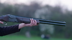 Woman training with a shotgun at sunset - stock footage