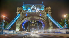 Time lapse footage of night time rush hour traffic on Tower of London Stock Footage