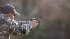 Elite special forces man with a gun training in camp - Steadicam shot at sunset Stock Footage