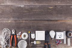 electrical tools and equipment on wooden background with copy space - stock photo