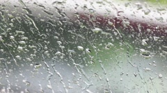 Drop rain in a car glass Stock Footage
