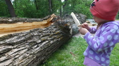 Child girl quickly polish a piece of wood. Stock Footage