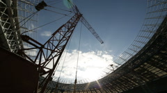 Construction crane working on the reconstruction of the stadium Stock Footage