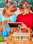 Children in chemistry class. Stock Photos