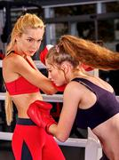 Two sport women are boxing on ring. Stock Photos
