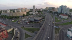 Flight across the road junction in the city on the sunset Stock Footage