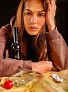 Girl in depression drinking alcohol. - stock photo