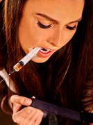 Female drug addict with syringe. - stock photo