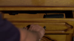 Man with bad intentions taking a gun from his drawer Stock Footage