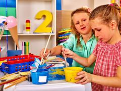 Group little girl with brush painting in primary school. - stock photo