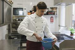 Chef cooking in commercial kitchen at cafe Stock Photos