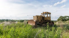 Old yellow tractor/excavator. Time lapse footage. Nature background. Stock Footage
