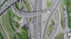 Vertical flight across the round road junction - stock footage