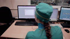 Researcher working with computer in pharmaceutical factory Stock Footage