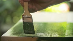 Painting a wooden board outdoor Stock Footage