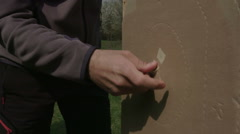 Man counting the points scored in a pistol shooting competition Stock Footage