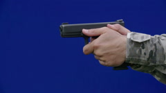 Training with a gun with blue screen background - stock footage