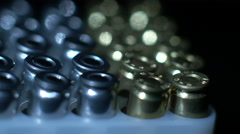 Macro shot of 9 mm handgun Bullets on a rotating table. dolly detail shot Stock Footage