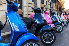 Multi-colored scooters Stock Photos