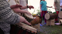 Group of people hands playing a drum - stock footage