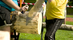 A log cutting competition using a saw Stock Footage