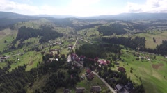 Aerial shot of village in the mountains - stock footage