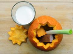 Orange Halloween pumpkin cut open - stock photo