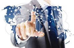 Man pressing dots on world map in global communication concept Stock Photos