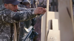 Special forces solider exercise shooting a gun while running at military camp Stock Footage
