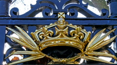 The golden crown on the fence Stock Footage