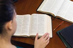 Young Lady Studying The Bible Stock Photos
