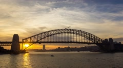 Aerial sunset timelapse of Sydney Harbour Bridge in 4k, medium shot Stock Footage
