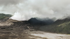 Crater of mountain Bromo volcano in Java Indonesia. Smoke eruption timelapse - stock footage