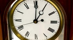 The clock ticks on one oclock Stock Footage